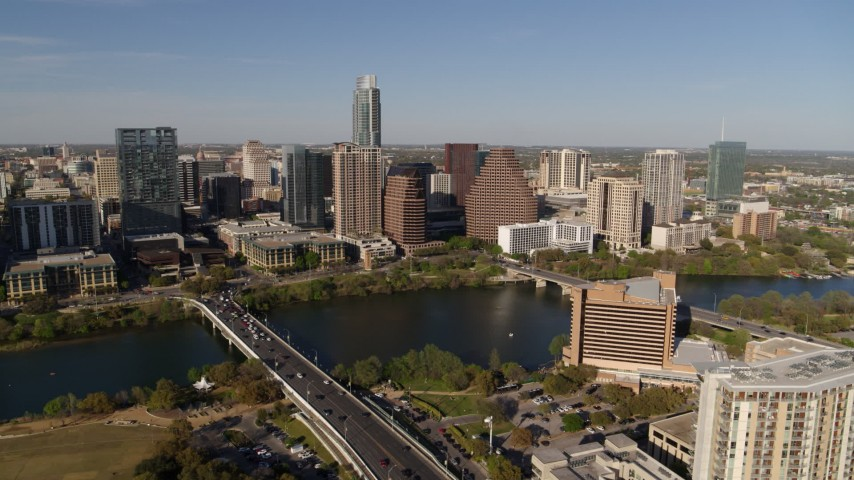 5.7K stock footage aerial video part of the city's waterfront skyline, and First Street Bridge over Lady Bird Lake, Downtown Austin, Texas Aerial Stock Footage | DX0002_109_024