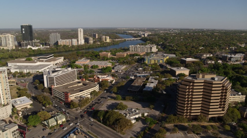 5.7K stock footage aerial video reverse view Lady Bird Lake, seen while flying near office building, Austin, Texas Aerial Stock Footage | DX0002_109_025