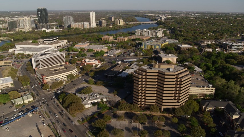 5.7K stock footage aerial video of two busy street intersections between hotel and office complex, Austin, Texas Aerial Stock Footage | DX0002_109_028