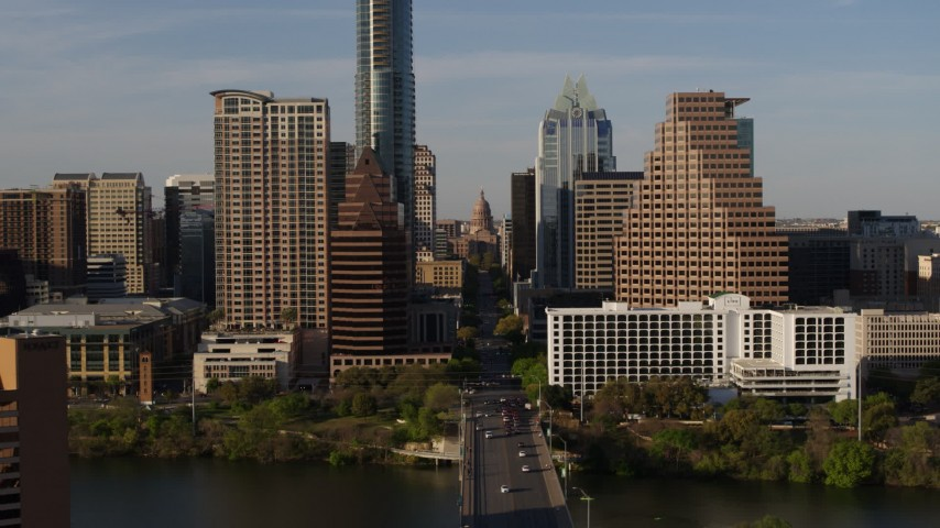 5.7K stock footage aerial video of revealing the Texas State Capitol seen between skyscrapers in Downtown Austin, Texas Aerial Stock Footage | DX0002_109_030