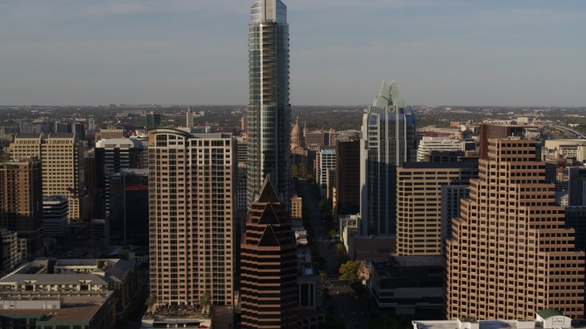5.7K stock footage aerial video of the Texas State Capitol seen while approaching The Austonian in Downtown Austin, Texas Aerial Stock Footage | DX0002_109_031