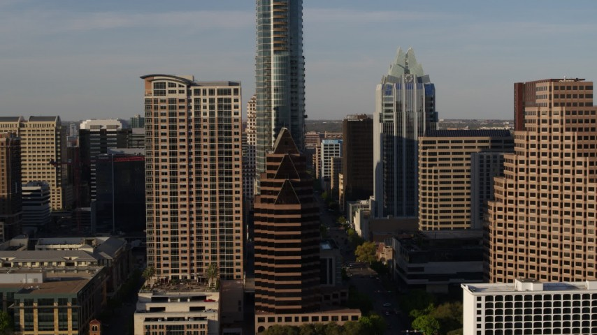 5.7K stock footage aerial video of downtown skyscrapers seen during descent in Downtown Austin, Texas Aerial Stock Footage | DX0002_109_032