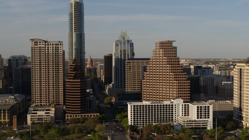 5.7K stock footage aerial video flyby downtown skyscrapers and reveal the state capitol in Downtown Austin, Texas Aerial Stock Footage | DX0002_109_033