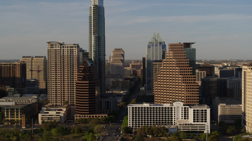 5.7K stock footage aerial video reveal the state capitol while flying between skyscrapers in Downtown Austin, Texas Aerial Stock Footage | DX0002_109_034