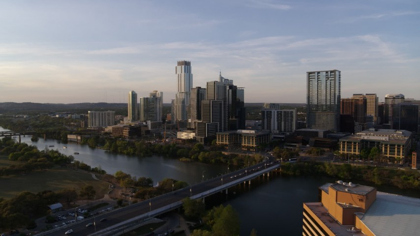 5.7K stock footage aerial video the city's waterfront skyline and Lady Bird Lake at sunset in Downtown Austin, Texas Aerial Stock Footage | DX0002_110_001