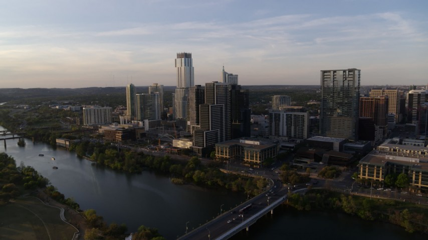 5.7K stock footage aerial video a wide orbit of the city's waterfront skyline and Lady Bird Lake at sunset in Downtown Austin, Texas Aerial Stock Footage | DX0002_110_002