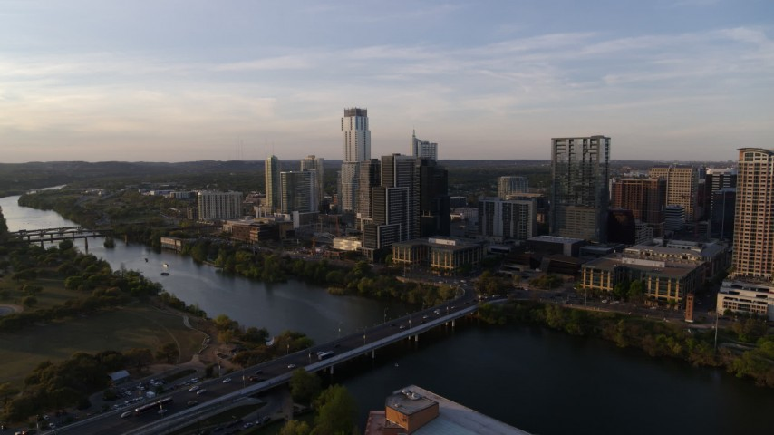 5.7K stock footage aerial video reverse view of the city's waterfront skyline and Lady Bird Lake at sunset in Downtown Austin, Texas Aerial Stock Footage | DX0002_110_003