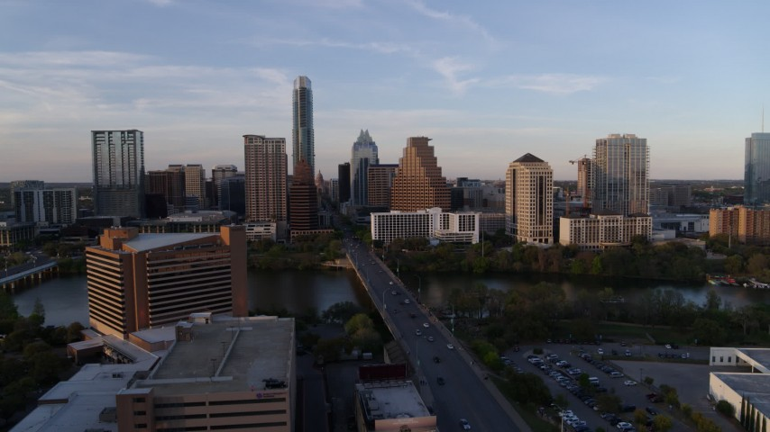 5.7K stock footage aerial video of skyline across bridge and Lady Bird Lake at sunset in Downtown Austin, Texas Aerial Stock Footage | DX0002_110_013