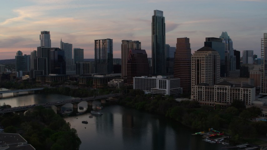 5.7K stock footage aerial video of a slow approach to the waterfront skyline from Lady Bird Lake at sunset in Downtown Austin, Texas Aerial Stock Footage | DX0002_110_022