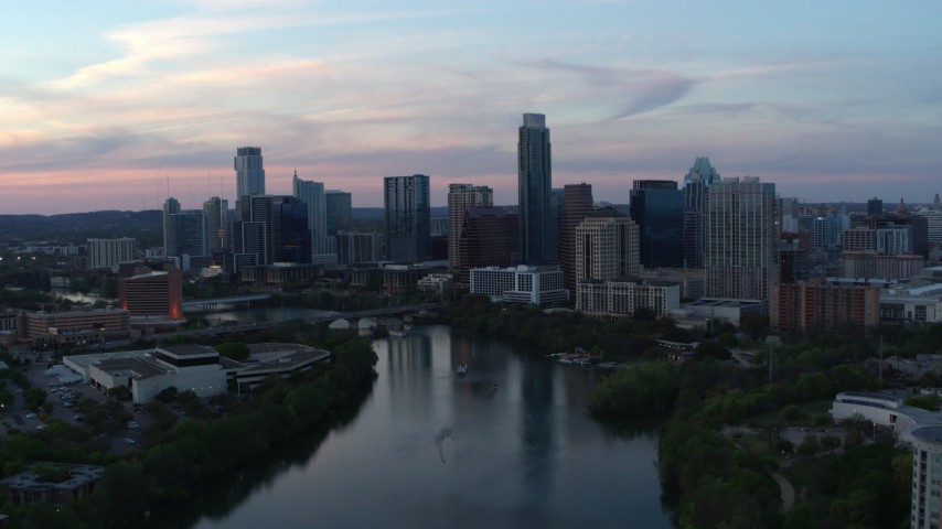 5.7K stock footage aerial video of the city skyline by Lady Bird Lake at twilight in Downtown Austin, Texas Aerial Stock Footage | DX0002_110_025