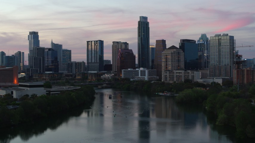 5.7K stock footage aerial video slowly approaching city skyline by Lady Bird Lake at twilight in Downtown Austin, Texas Aerial Stock Footage | DX0002_110_026