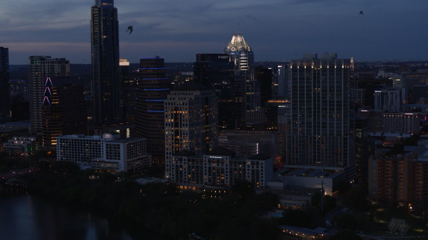 5.7K aerial video fly away from, then approach, San Jacinto Center at twilight in Downtown Austin, Texas Aerial Stock Footage | DX0002_110_041