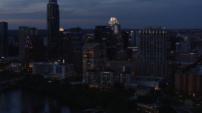 5.7K aerial video fly away from San Jacinto Center at twilight in Downtown Austin, Texas Aerial Stock Footage | DX0002_110_042