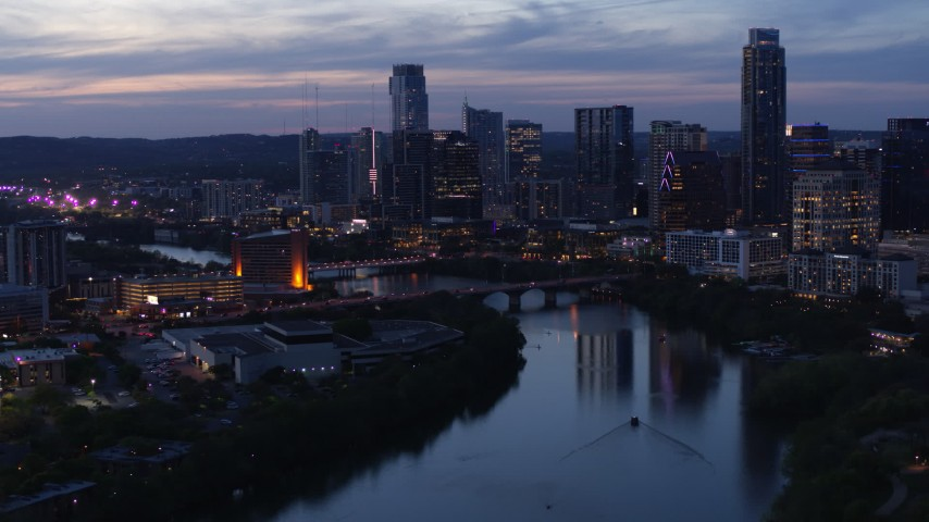 5.7K aerial video of Congress Avenue Bridge, Lady Bird Lake, skyline at twilight in Downtown Austin, Texas Aerial Stock Footage | DX0002_110_045