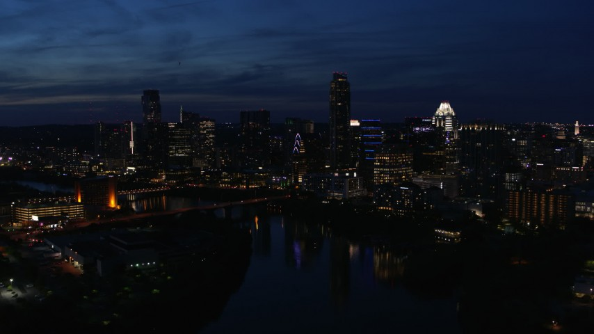 5.7K aerial video of the waterfront skyline on the shore of Lady Bird Lake at twilight in Downtown Austin, Texas Aerial Stock Footage | DX0002_111_006