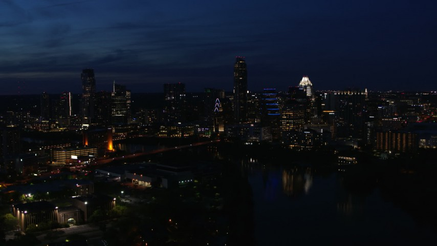 5.7K aerial video of the city's waterfront skyline on the shore of Lady Bird Lake at twilight in Downtown Austin, Texas Aerial Stock Footage | DX0002_111_007
