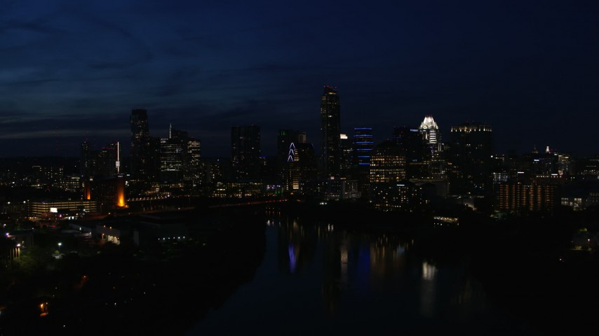 5.7K stock footage aerial video city's waterfront skyline on the opposite shore of Lady Bird Lake at night in Downtown Austin, Texas Aerial Stock Footage | DX0002_111_012