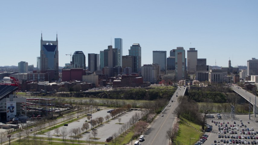 5.7K stock footage aerial video ascend for view of city's skyline near the river in Downtown Nashville, Tennessee Aerial Stock Footage | DX0002_112_001