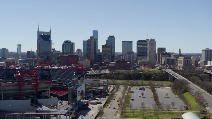 5.7K stock footage aerial video of the city's skyline seen while passing football stadium in Downtown Nashville, Tennessee Aerial Stock Footage | DX0002_112_006