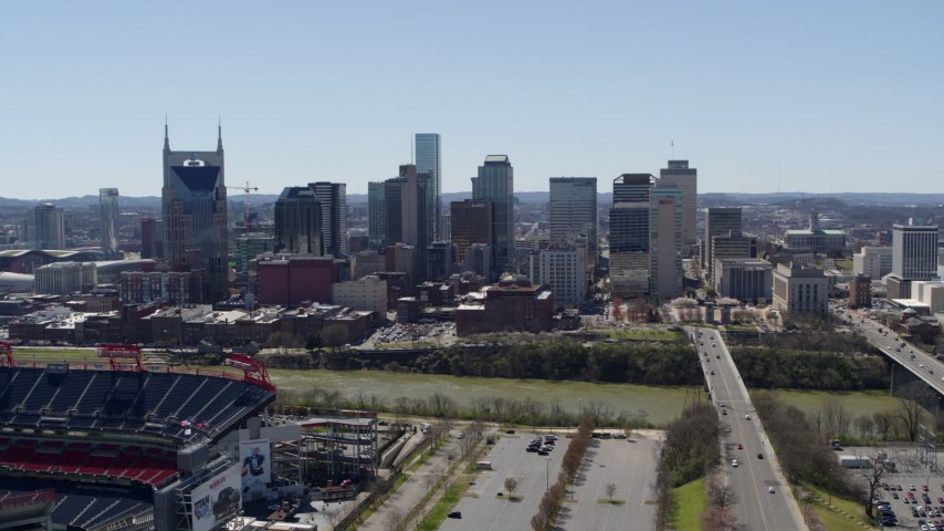 5.7K stock footage aerial video of the city's skyline seen while ascending near football stadium in Downtown Nashville, Tennessee Aerial Stock Footage | DX0002_112_007