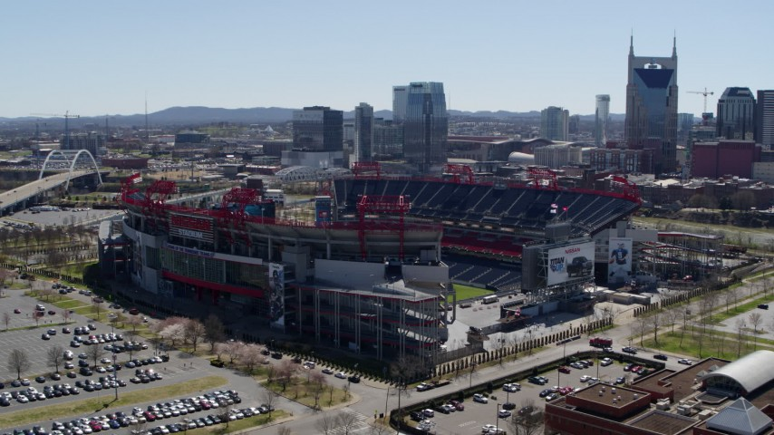 5.7K stock footage aerial video of a reverse view of the football stadium during descent in Nashville, Tennessee Aerial Stock Footage | DX0002_112_009