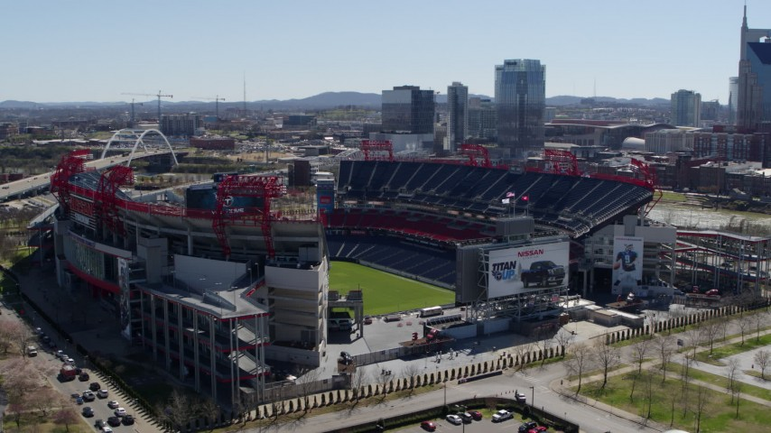5.7K stock footage aerial video of orbiting the football stadium with view of the field in Nashville, Tennessee Aerial Stock Footage | DX0002_112_010