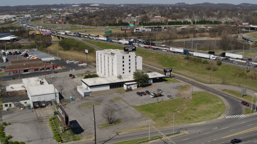 5.7K stock footage aerial video of orbiting a hotel by the freeway in Nashville, Tennessee Aerial Stock Footage | DX0002_112_012