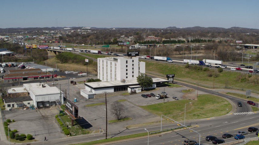 5.7K stock footage aerial video of circling a hotel by the freeway in Nashville, Tennessee Aerial Stock Footage | DX0002_112_013
