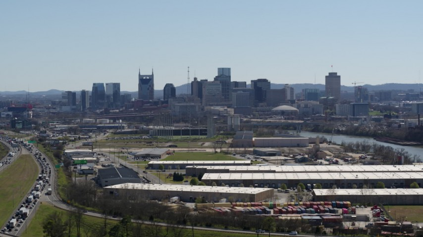 5.7K stock footage aerial video a wide view of the city's skyline seen from warehouse buildings in Downtown Nashville, Tennessee Aerial Stock Footage | DX0002_112_014