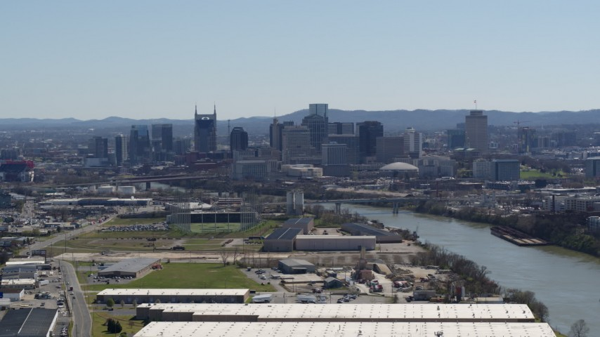 5.7K stock footage aerial video a wide view of the city's skyline by the Cumberland River in Downtown Nashville, Tennessee Aerial Stock Footage | DX0002_112_016