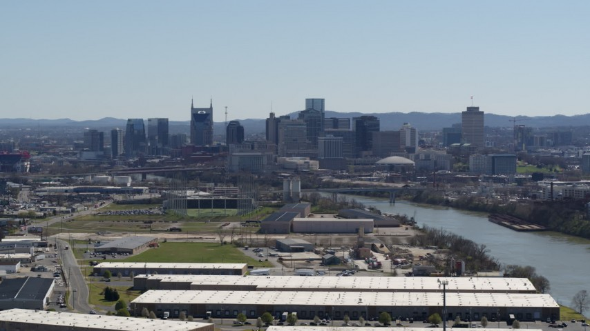 5.7K stock footage aerial video a wide view of the city's riverfront skyline and Cumberland River in Downtown Nashville, Tennessee Aerial Stock Footage | DX0002_112_017