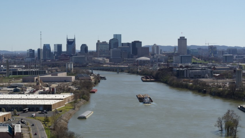 5.7K stock footage aerial video a wide view of the city's skyline seen from near barge on the river in Downtown Nashville, Tennessee Aerial Stock Footage | DX0002_112_019