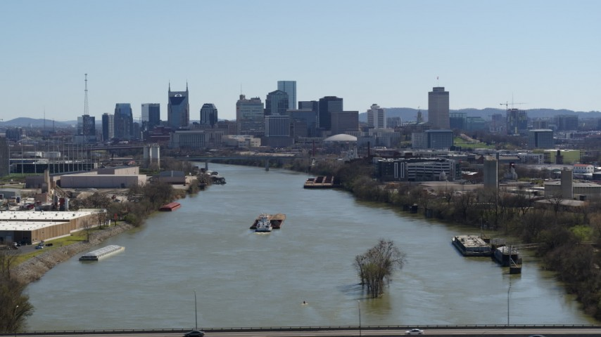5.7K stock footage aerial video a wide view of the city's skyline a barge sails the river in Downtown Nashville, Tennessee Aerial Stock Footage | DX0002_112_020