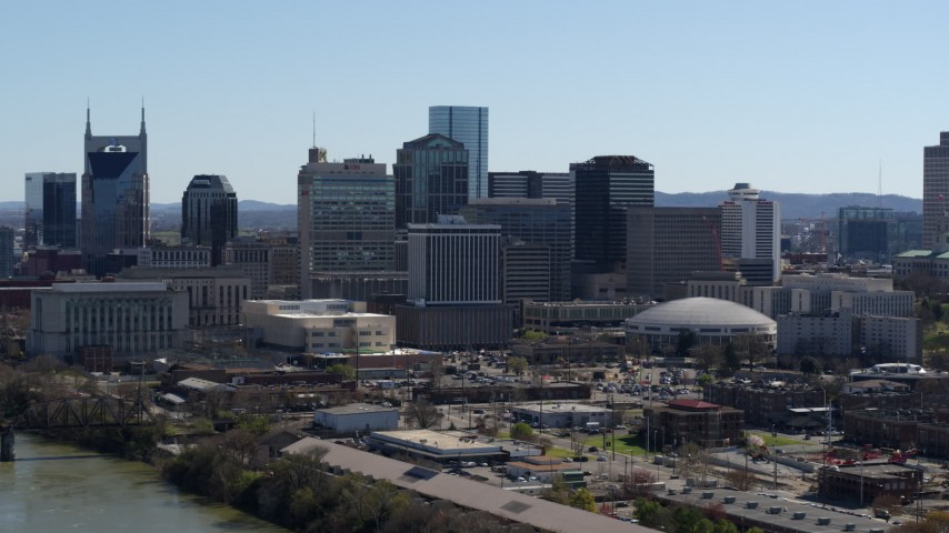 5.7K stock footage aerial video of the city's skyline on the opposite side of the river, Downtown Nashville, Tennessee Aerial Stock Footage | DX0002_112_030