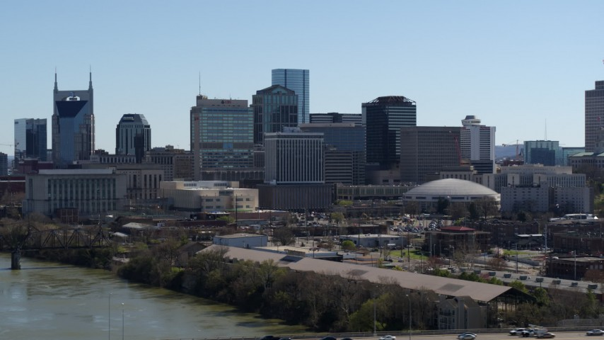 5.7K stock footage aerial video of the city's skyline while flying by the Cumberland River, Downtown Nashville, Tennessee Aerial Stock Footage | DX0002_112_031