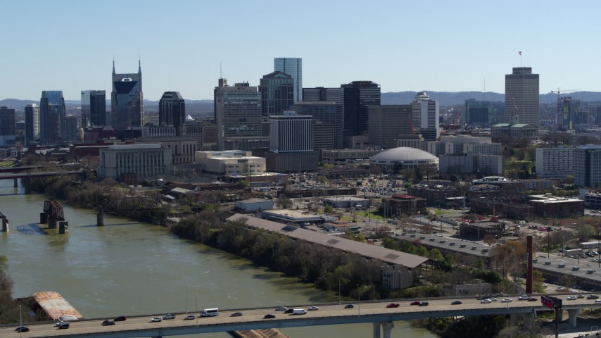5.7K stock footage aerial video reverse view of skyline, reveal bridge spanning the river, Downtown Nashville, Tennessee Aerial Stock Footage | DX0002_113_003