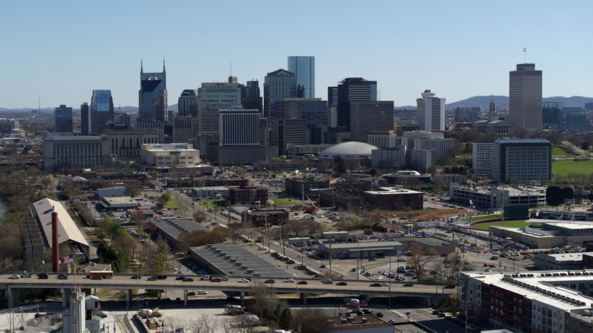 5.7K stock footage aerial video ascend and approach the city's skyline, Downtown Nashville, Tennessee Aerial Stock Footage | DX0002_113_009