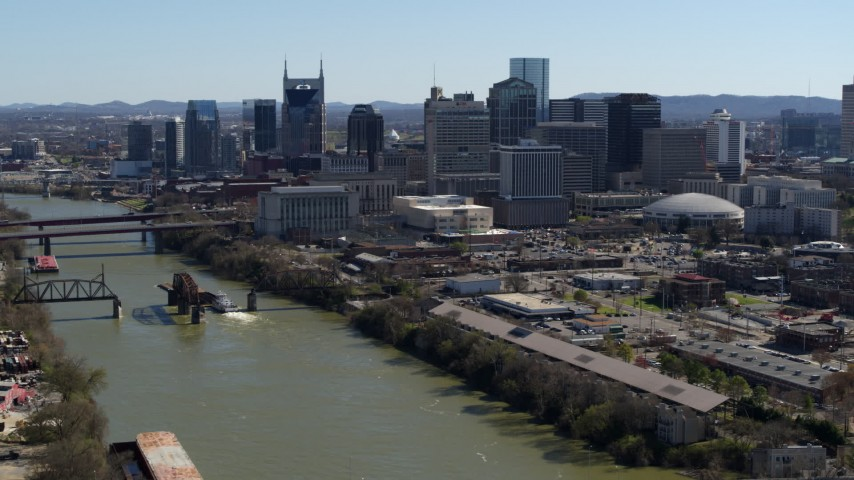 5.7K stock footage aerial video of skyscrapers in the city's skyline, seen from the river, Downtown Nashville, Tennessee Aerial Stock Footage | DX0002_113_011