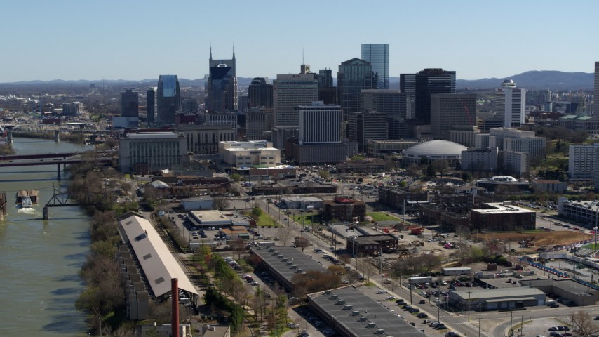 5.7K stock footage aerial video of the city's riverfront skyline, seen while ascending by the river, Downtown Nashville, Tennessee Aerial Stock Footage | DX0002_113_014