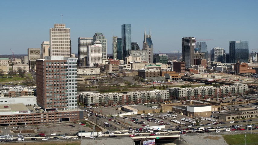 5.7K stock footage aerial video of the city's skyline seen from apartment complexes in Downtown Nashville, Tennessee Aerial Stock Footage | DX0002_113_016