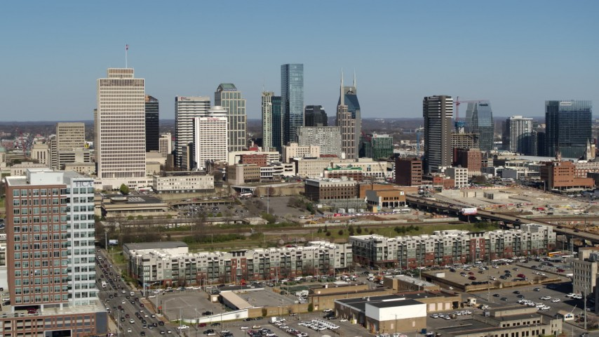 5.7K stock footage aerial video ascend for view of city's skyline behind apartment buildings in Downtown Nashville, Tennessee Aerial Stock Footage | DX0002_113_020