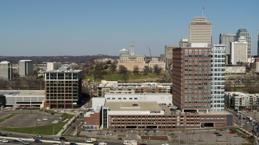 5.7K stock footage aerial video approach and ascend by office buildings in Nashville, Tennessee Aerial Stock Footage   DX0002_113_029