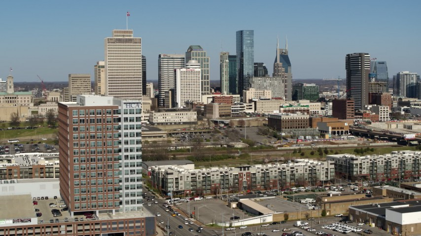 5.7K stock footage aerial video fly away from office building, skyline in distance, Downtown Nashville, Tennessee Aerial Stock Footage | DX0002_113_030