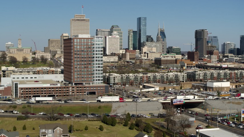 5.7K stock footage aerial video descend near office building, skyline in distance, Downtown Nashville, Tennessee Aerial Stock Footage | DX0002_113_031