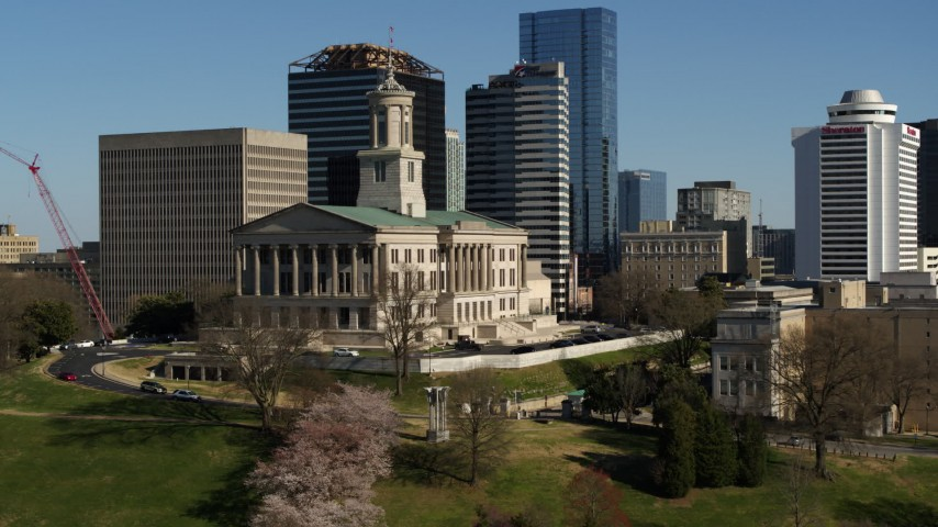 5.7K stock footage aerial video of descending near the Tennessee State Capitol building in Downtown Nashville, Tennessee Aerial Stock Footage | DX0002_113_034