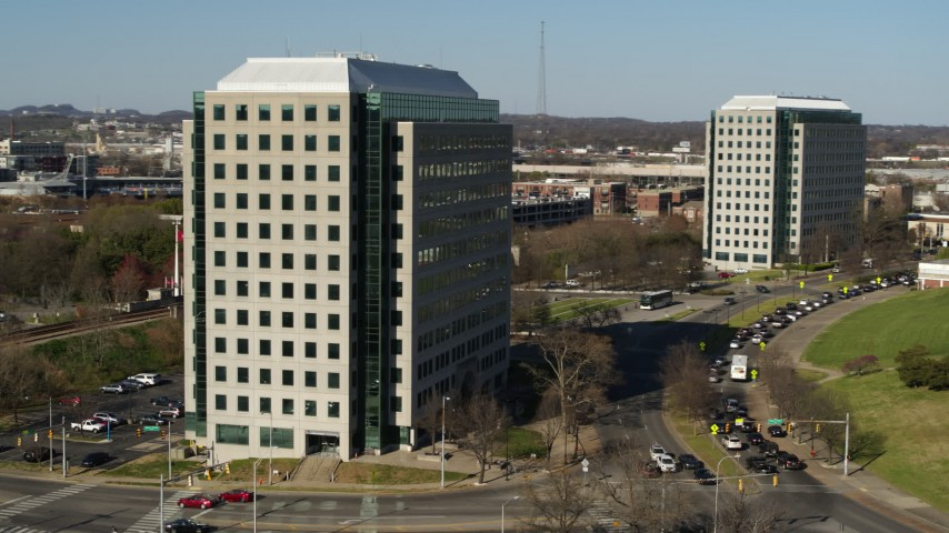 5.7K stock footage aerial video of orbiting a government office building to reveal a second building in Downtown Nashville, Tennessee Aerial Stock Footage | DX0002_113_045