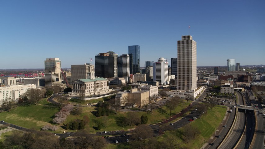 5.7K stock footage aerial video of the Tennessee State Capitol, Tennessee Tower near skyscrapers in Downtown Nashville, Tennessee Aerial Stock Footage | DX0002_114_002