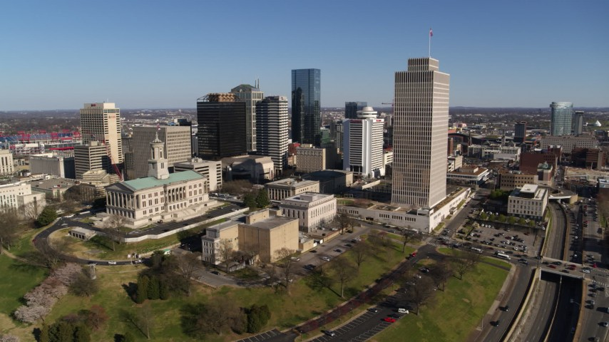 5.7K stock footage aerial video wide orbit of the Tennessee State Capitol, Tennessee Tower near skyscrapers in Downtown Nashville, Tennessee Aerial Stock Footage | DX0002_114_003