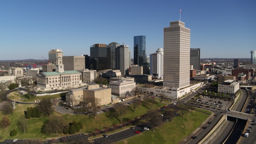 5.7K stock footage aerial video wide orbit of the Tennessee State Capitol, skyscrapers, Tennessee Tower in Downtown Nashville, Tennessee Aerial Stock Footage DX0002_114_005 | Axiom Images