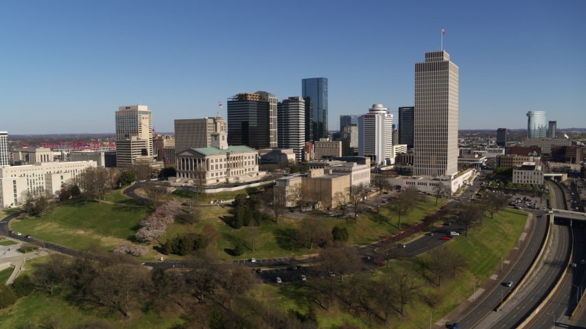 5.7K stock footage aerial video reverse view of the Tennessee State Capitol, skyscrapers, Tennessee Tower in Downtown Nashville, Tennessee Aerial Stock Footage | DX0002_114_006